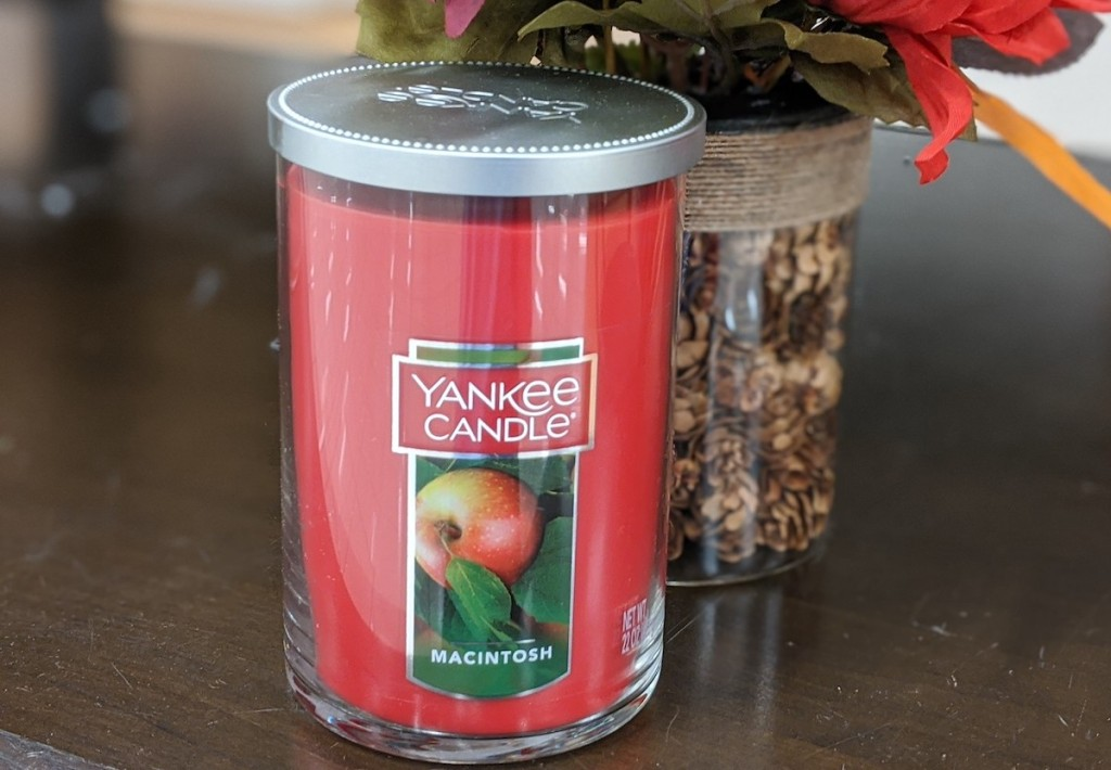 macintosh fall yankee candle sitting on table