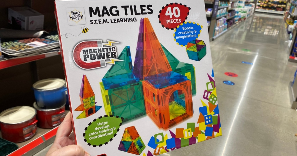mag tiles at ALDI in hand in aisle