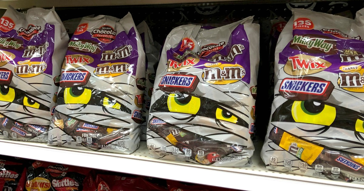 bags of halloween candy on a store shelf