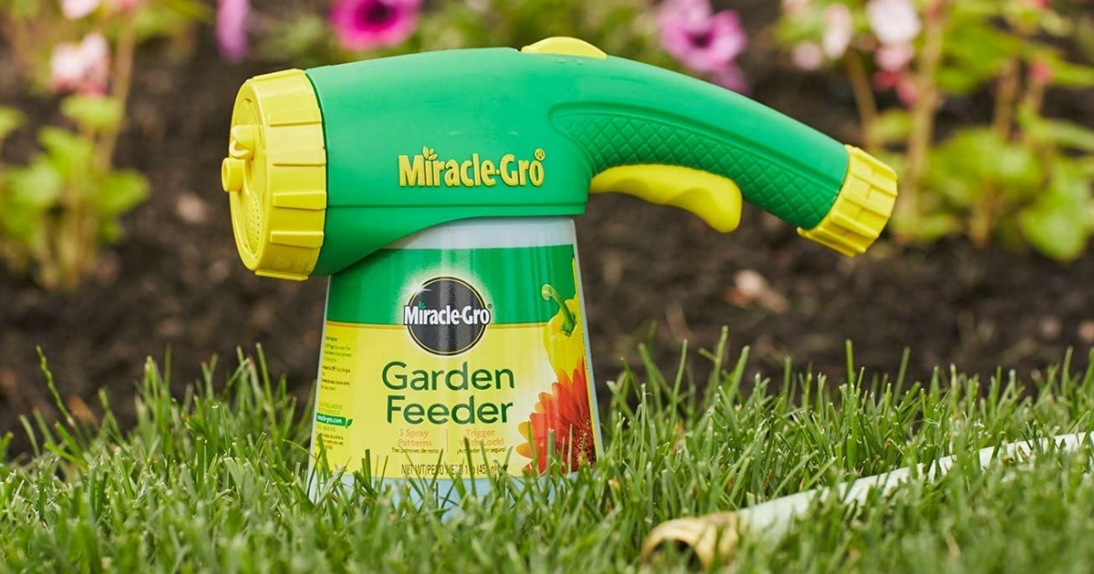 miracle gro plant food sprayer sitting on the lawn