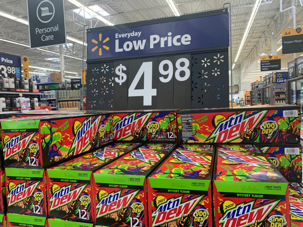 store display with price sign and cases of soda stacked up
