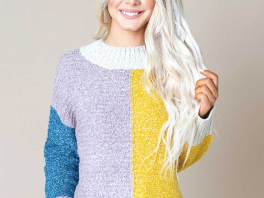 woman wearing a multi colored sweater