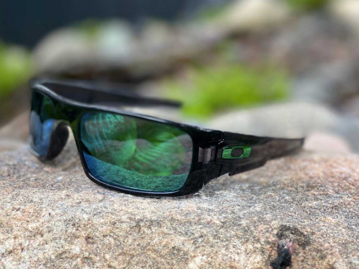 pair of oakley sunglasses on a rock