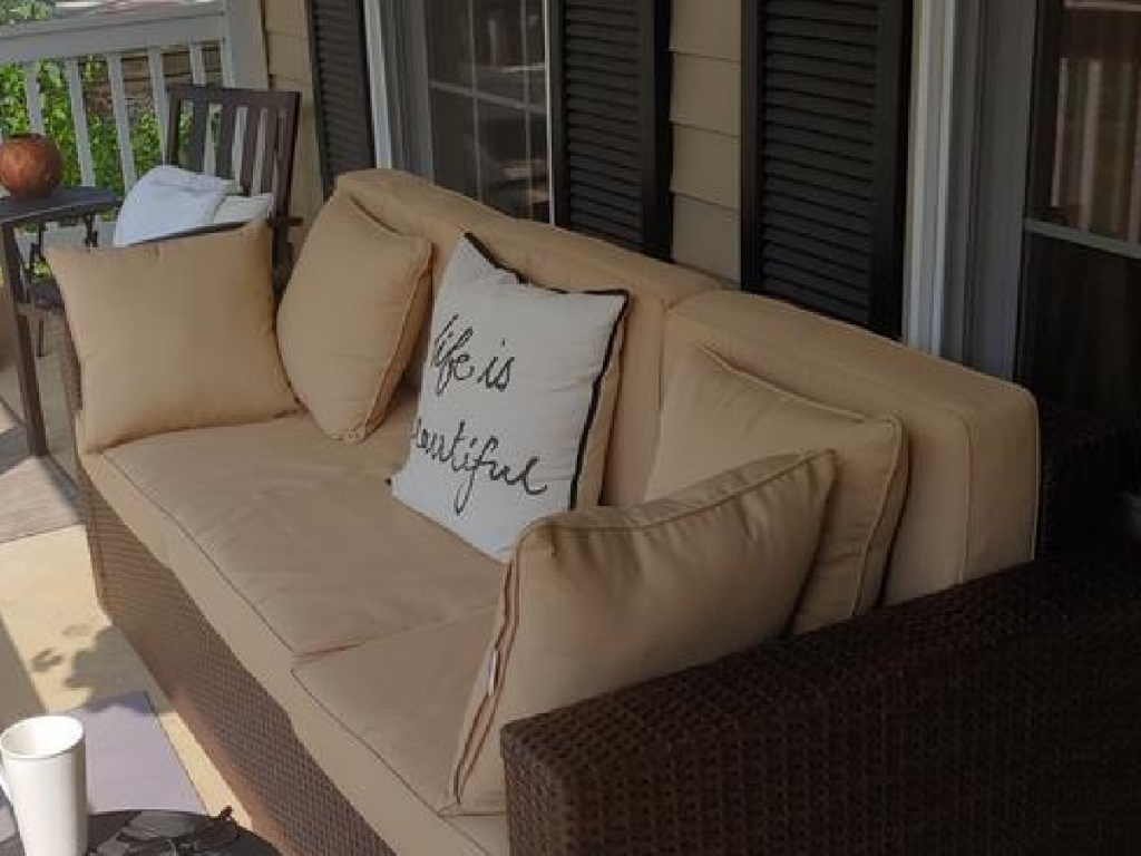 tan couch sitting on front porch