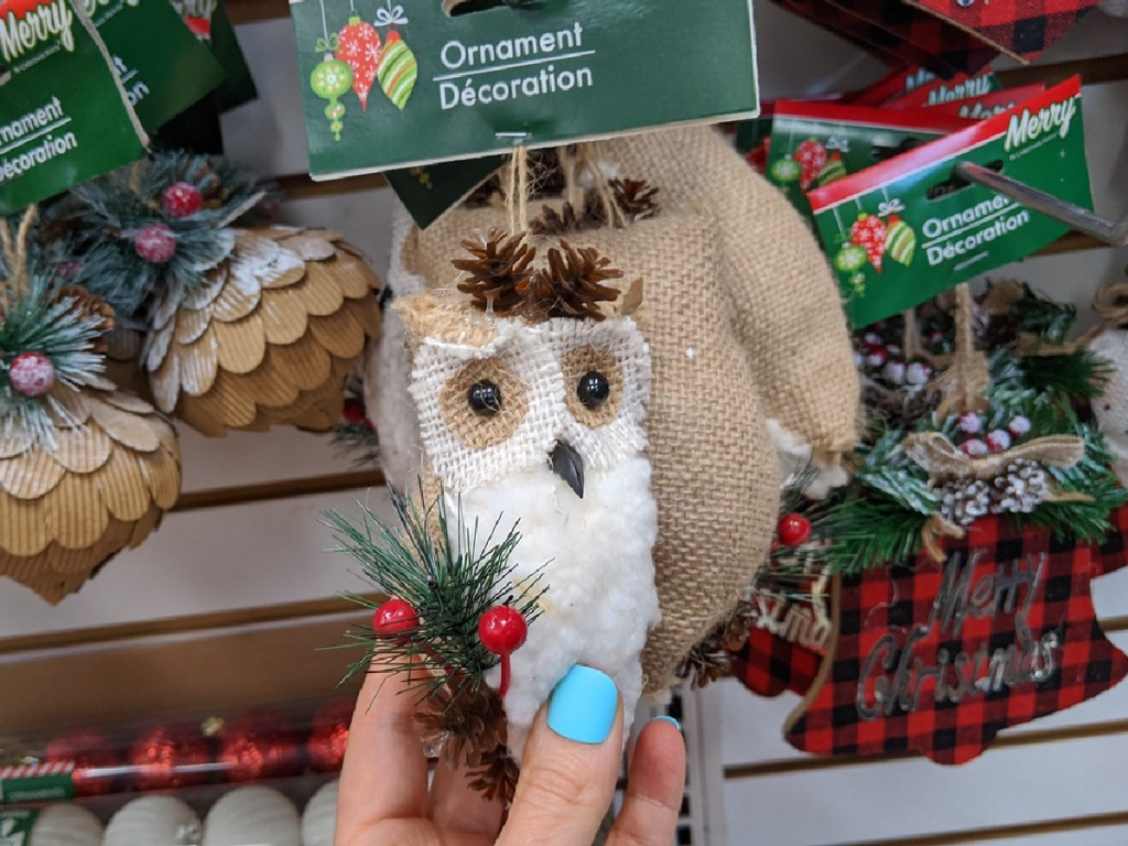 hand holding ornament representing an owl