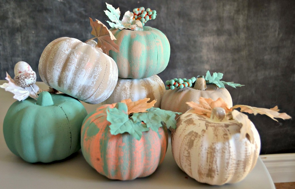 painted pumpkins stacked on top of each other