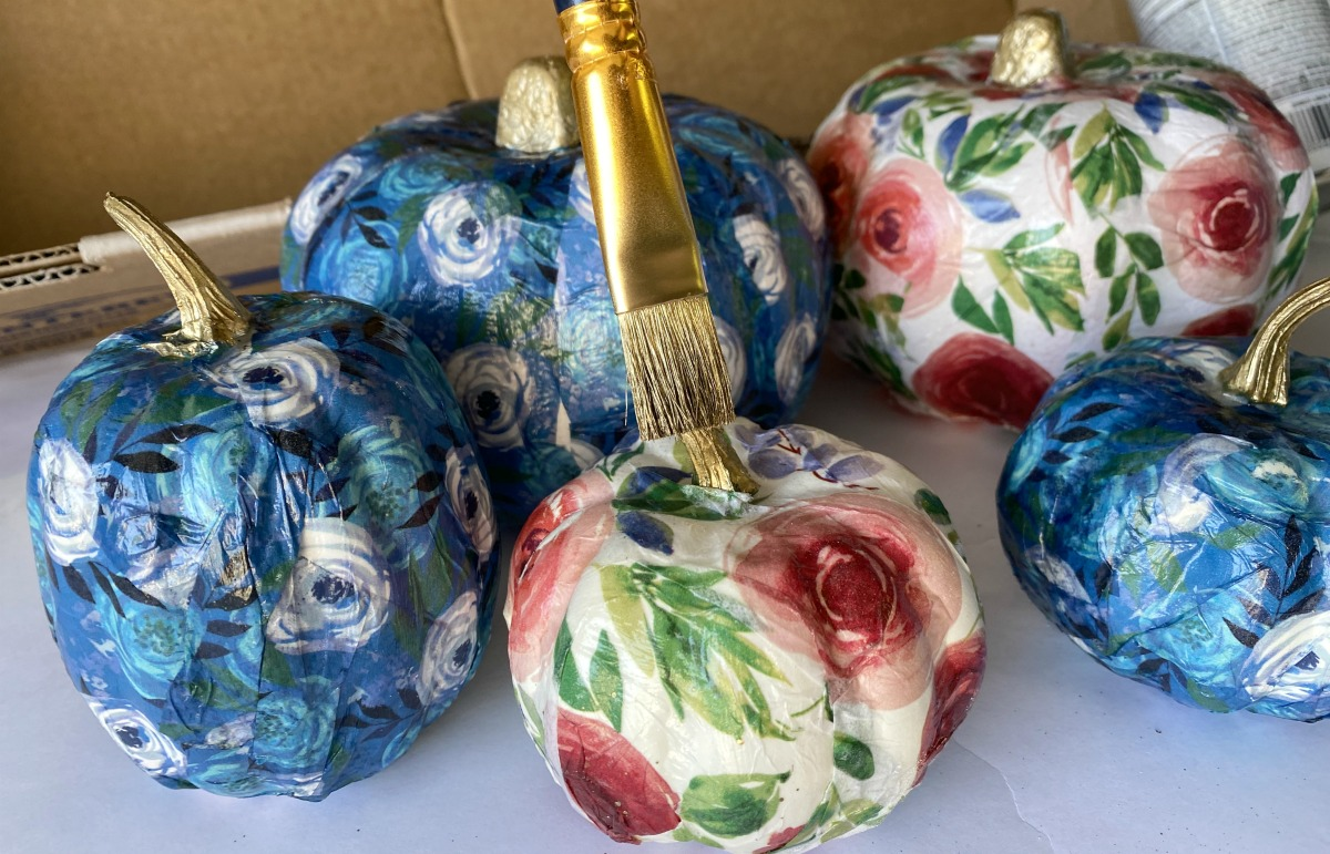 painting the stems of craft pumpkins gold