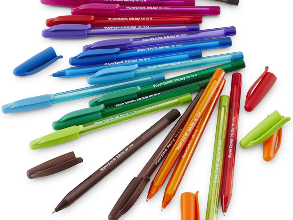 assorted colored pens laying on white surface