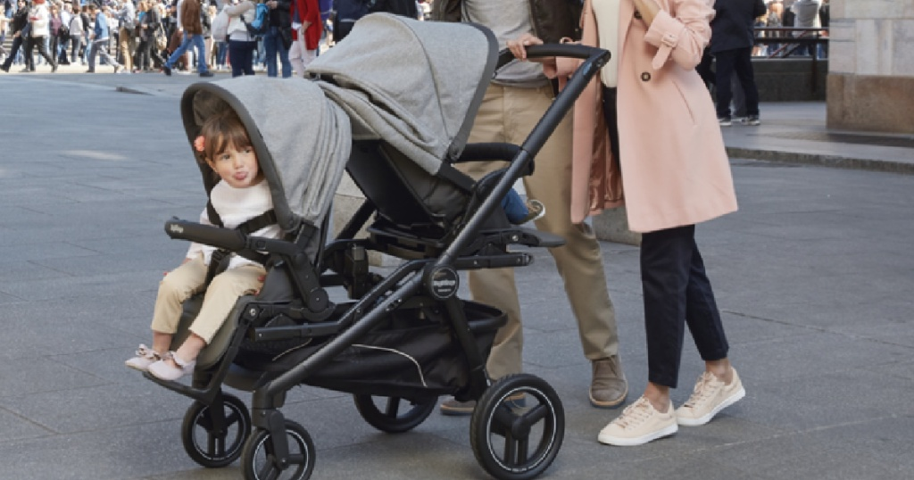 little kid in stroller sticking her tongue out
