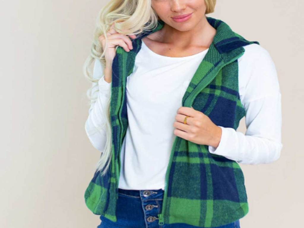 woman wearing a green and blue plaid vest