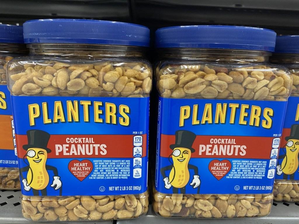 big tubs of Planters Peanuts on shelf