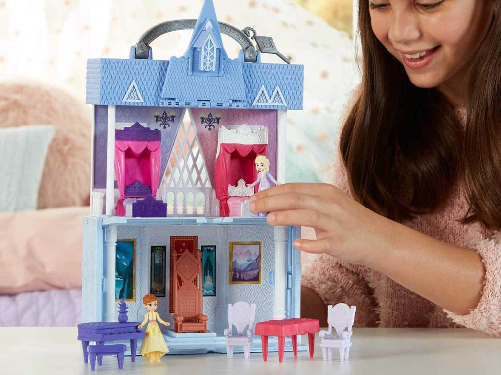 girl playing with disney frozen house
