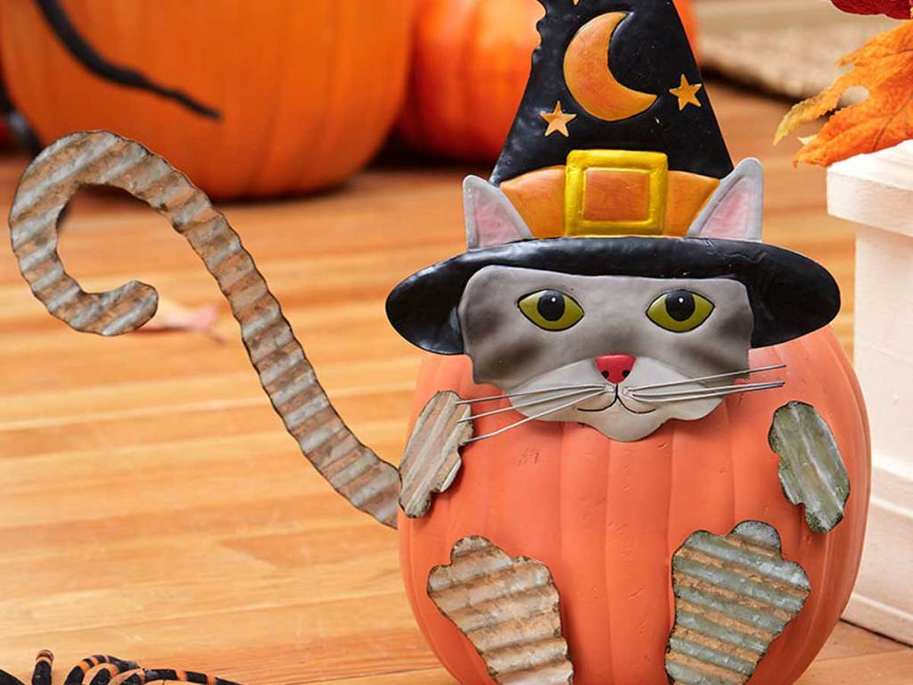pumpkin stakes to create a cat