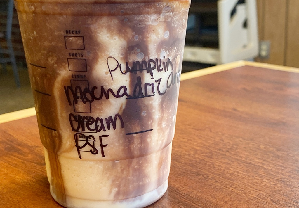 pumpkin frappuccino cup with the order written on the cup