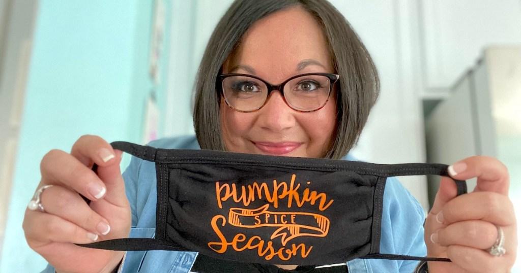 woman holding pumpkin spice face mask