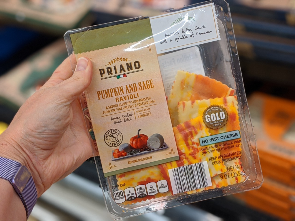 hand holding package of fresh ravioli in store