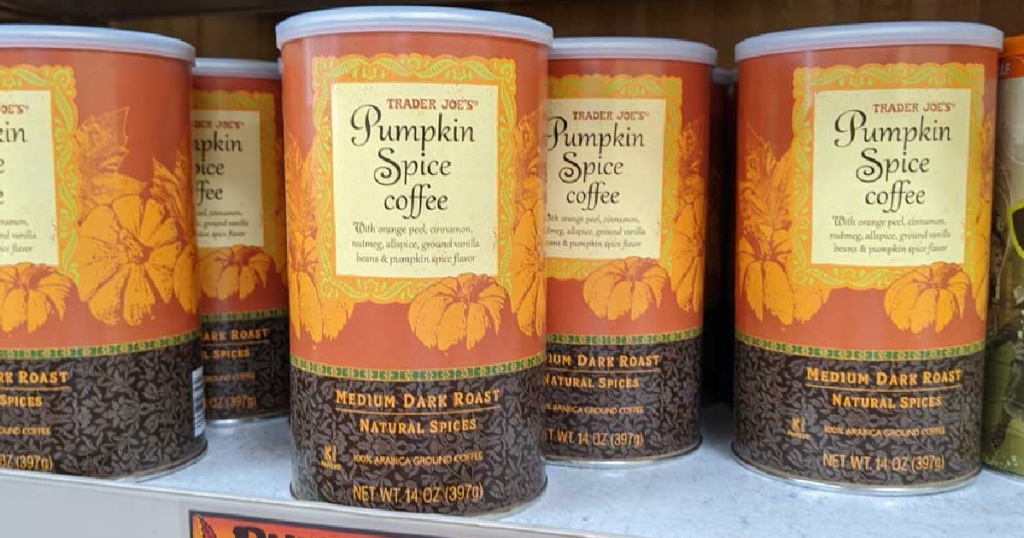 cans of pumpkin spice coffee on store shelf