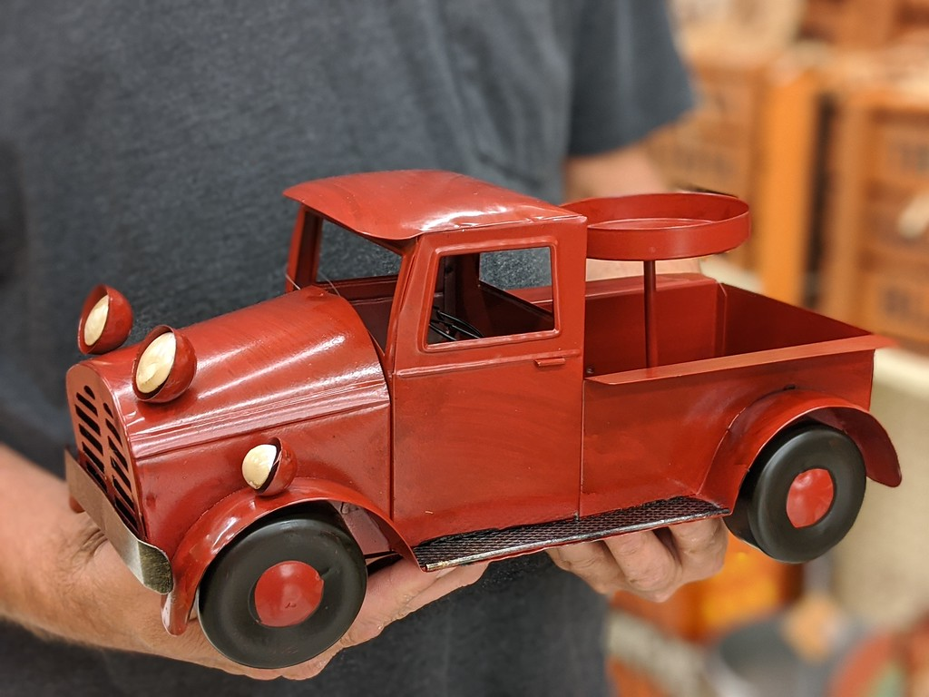 red vintage truck with candle holder at hobby lobby