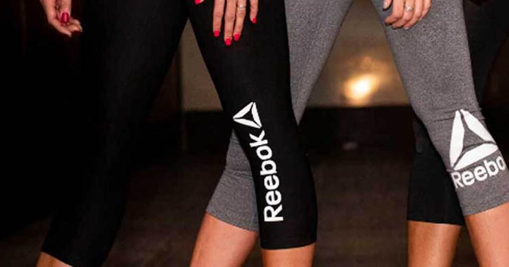 woman wearing reebok capri leggings
