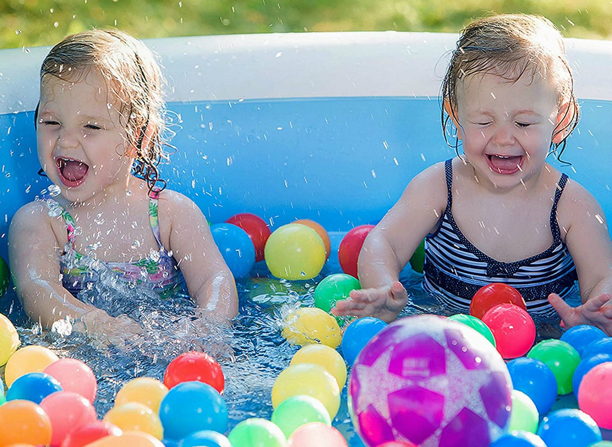 toddlers playing in inflatable pool