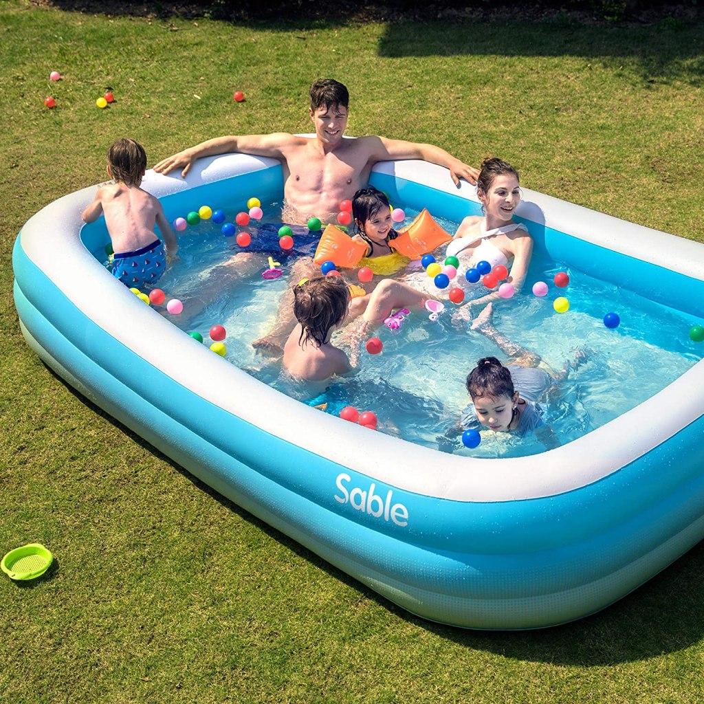 sable family size pool with people swimming
