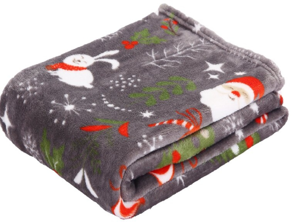 blanket that looks soft with Santa on it, folded neatly