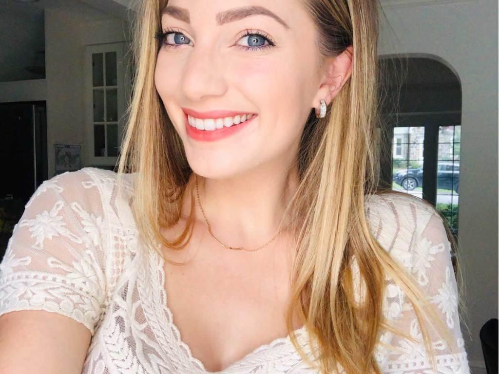 woman wearing a pair of diamond hoop earrings