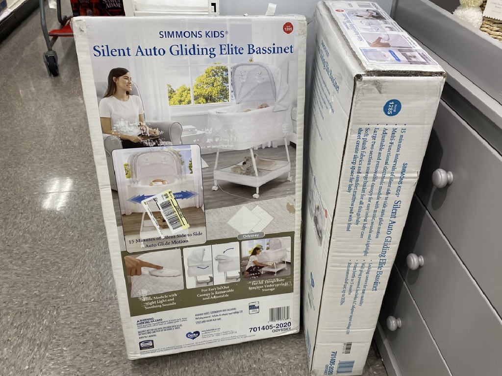 box with baby bassinet inside store
