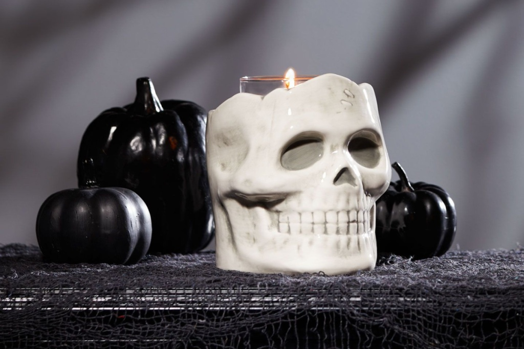 skull candle holder with black pumpkins