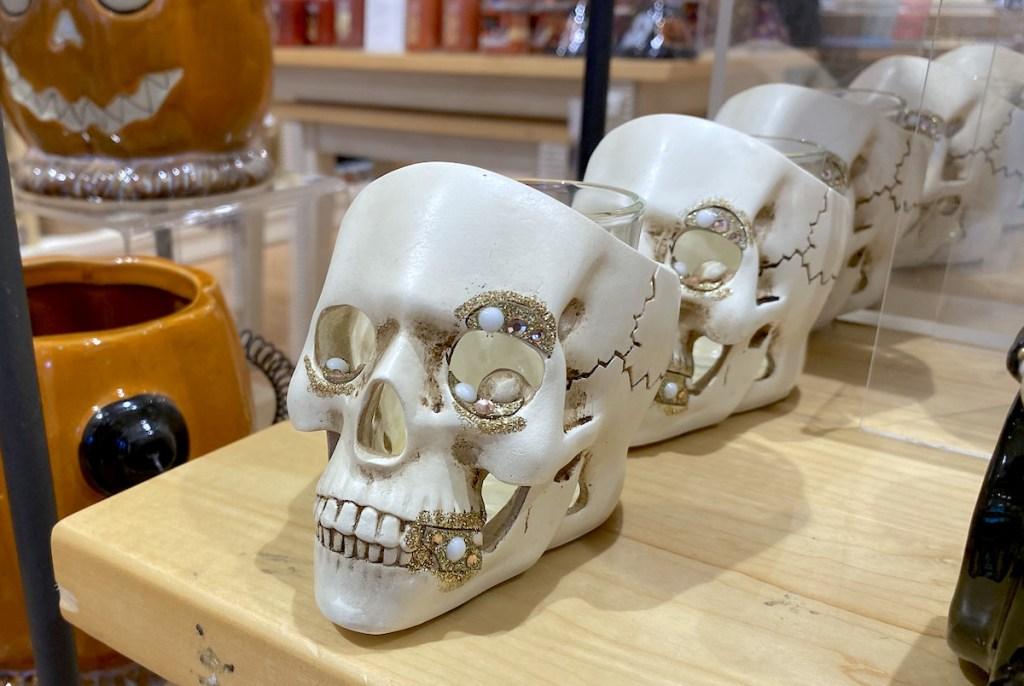 white skull candle holder on store shelf