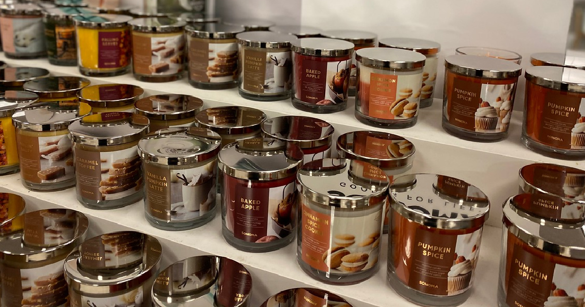 rows of candles on display in store