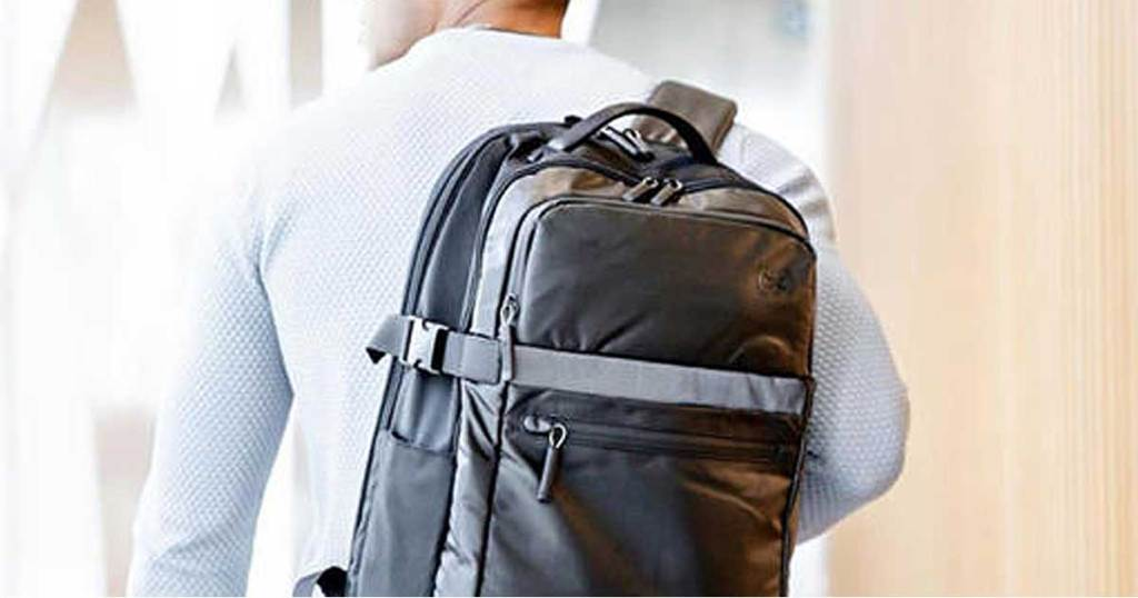 man wearing a grey backpack