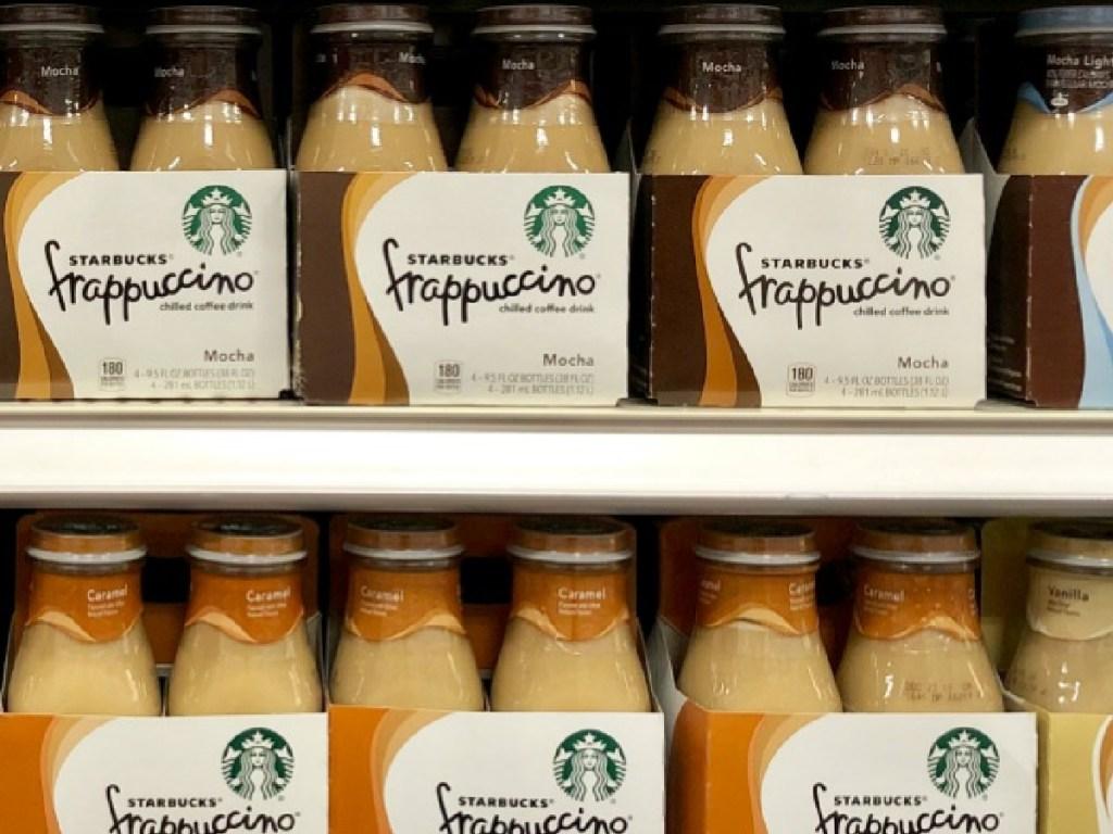 store shelf with 4packs of Starbucks bottled drinks on it