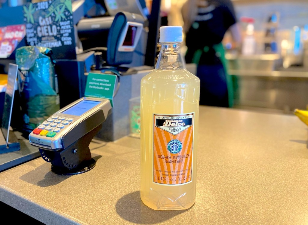 starbucks syrup sitting on checkout counter