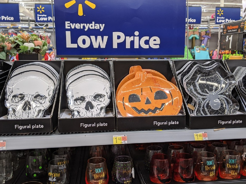 store display with plates shaped like skulls, pumpkins and spiders