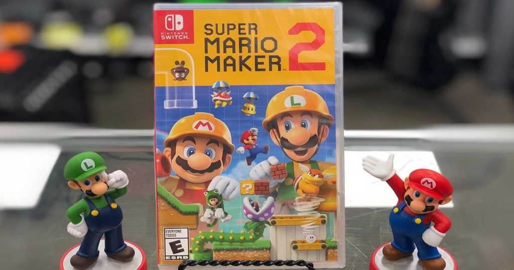 super mario maker game on counter with mario and luigi figurines