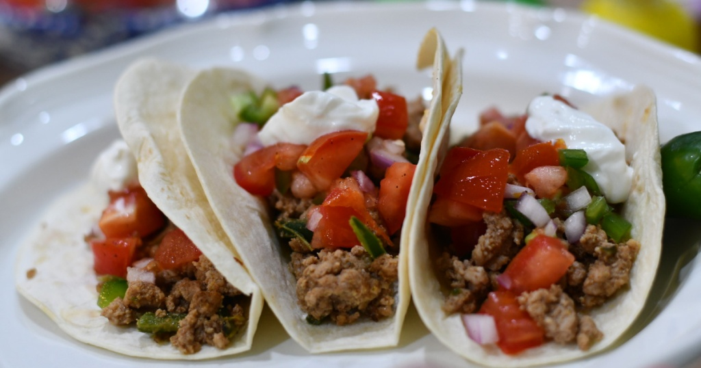 white plate with three soft tacos