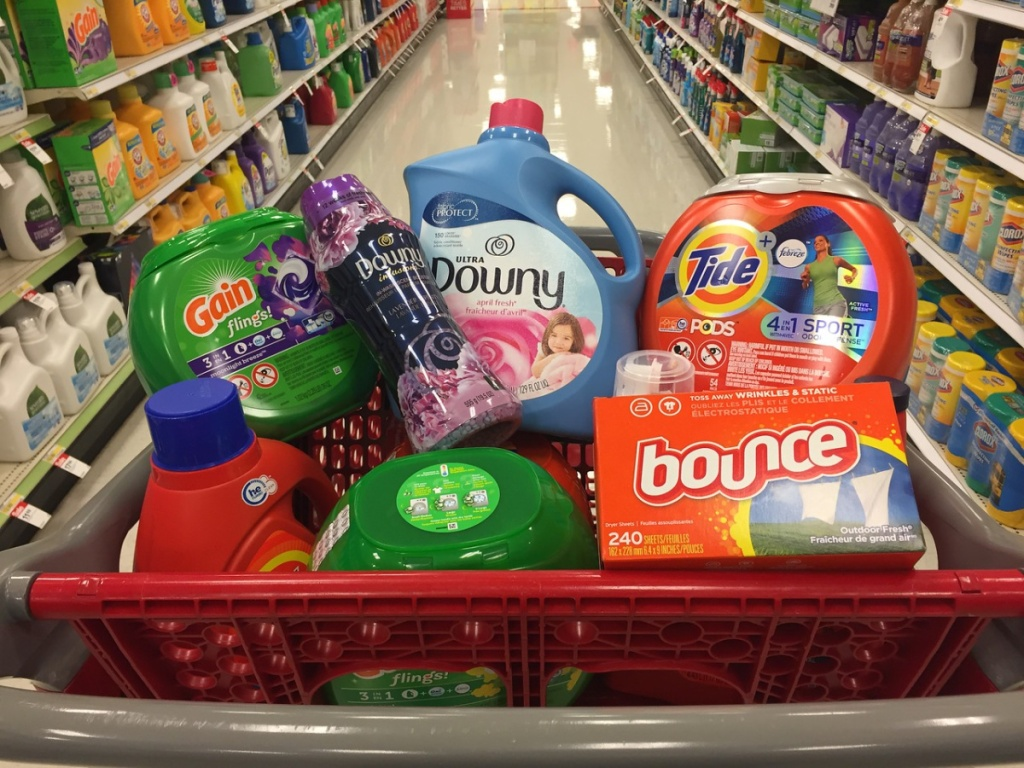red grocery basket full of laundry products in a store