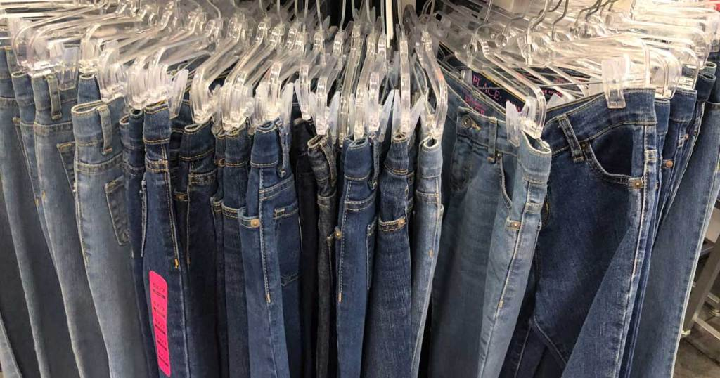 children's jeans on a rack in a store