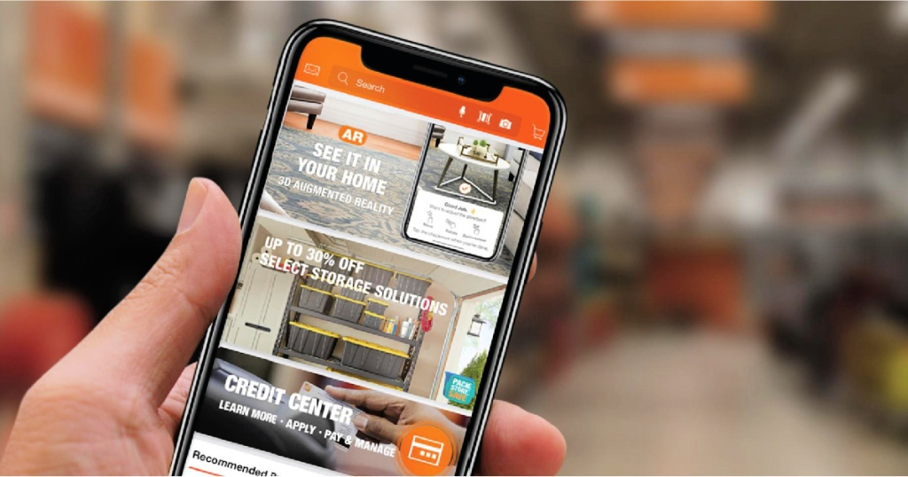the home depot app on phone in person's hand