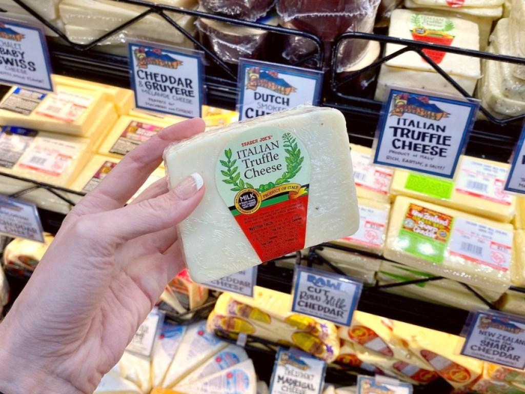 holding Italian truffle cheese at Trader Joe's