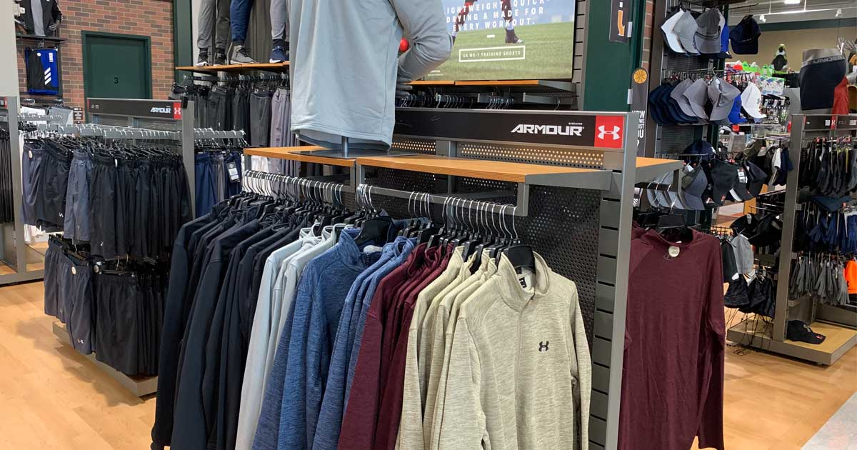mens under armour pullovers on display in a store