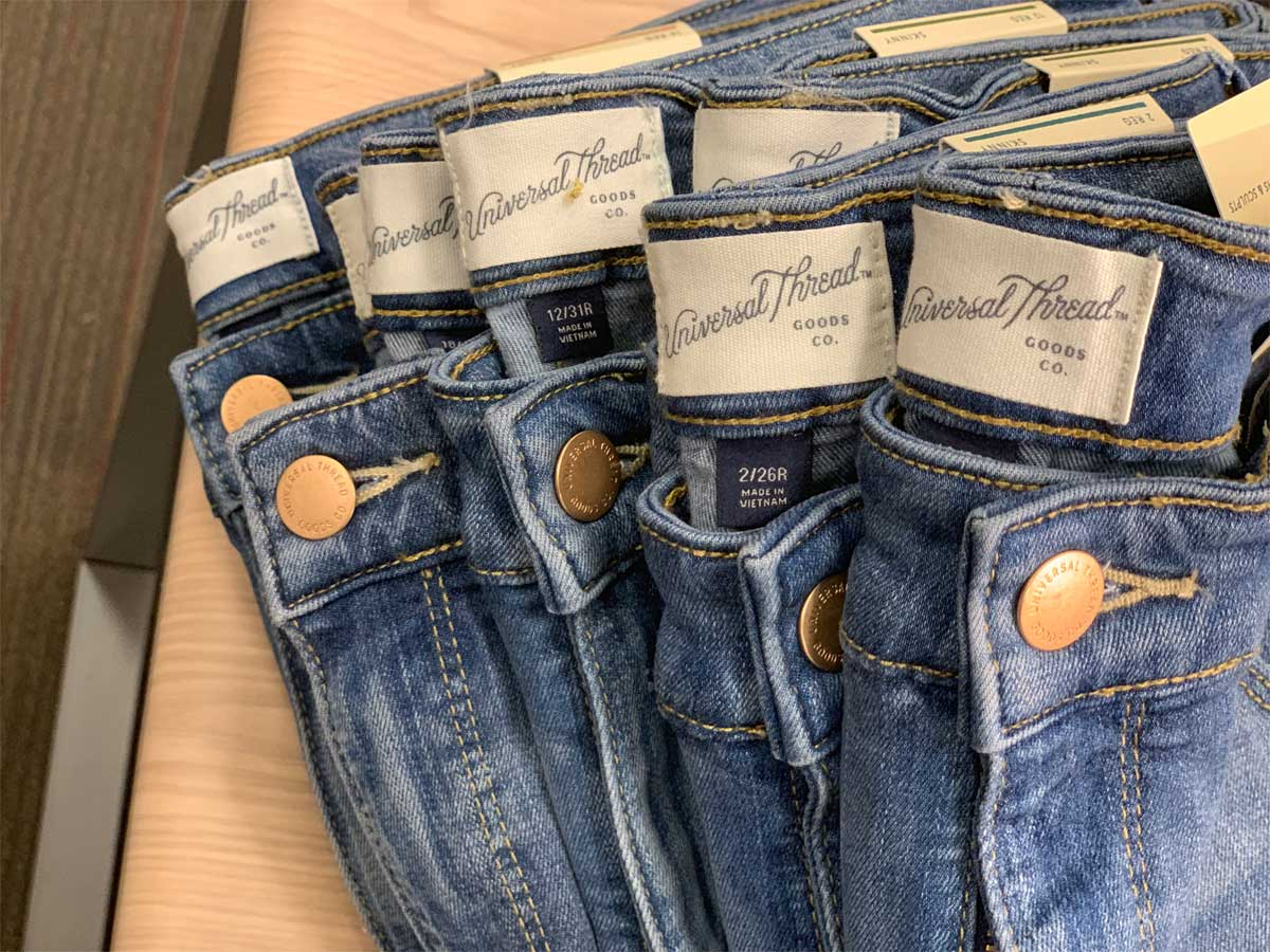 women's name brand jeans on a table in a store