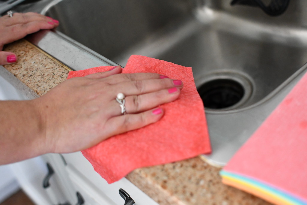 using a swedish dishcloth by the sink