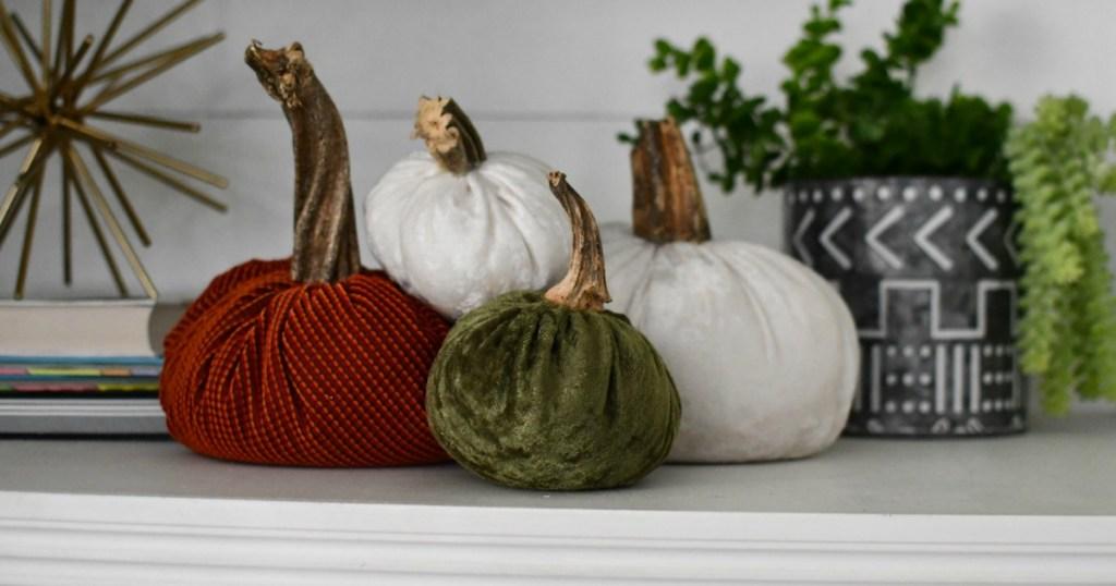 velvet pumpkins displayed on table