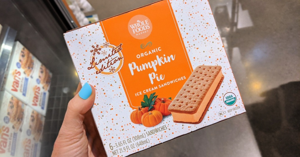whole foods pumpkin pie ice cream bars in woman's hand at store