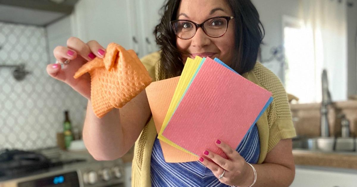 woman holding Swedish dishcloths