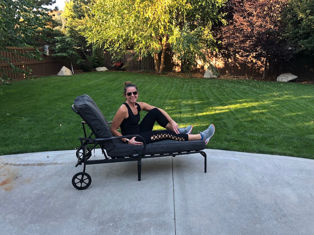woman on lounge chair outside on lounger