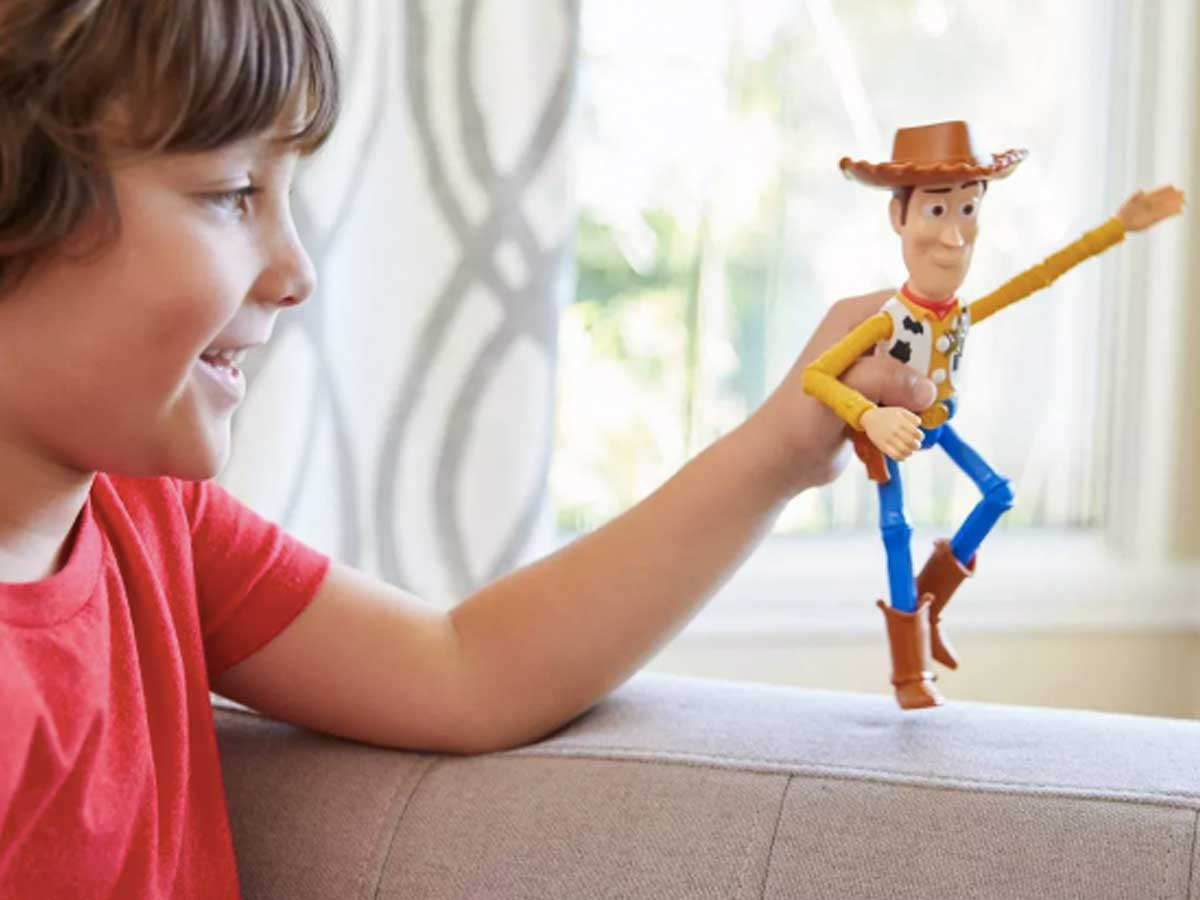 boy playing with woody toy figure