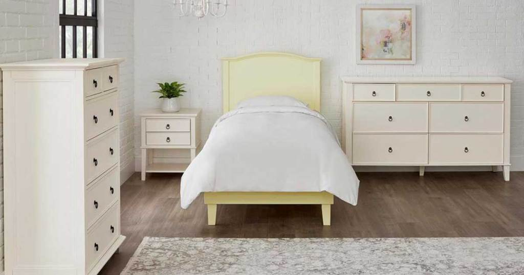 yellow bed with curved in a bedroom